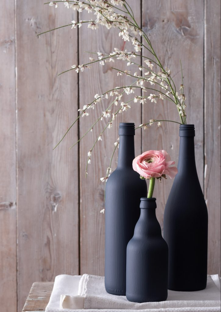 pianted bottles as vases